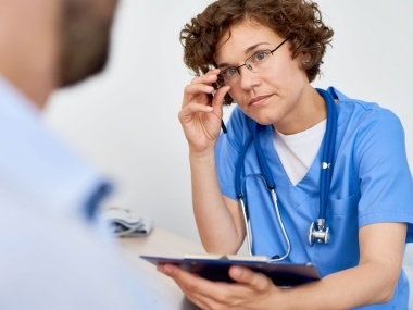 [female physician listening to patient]